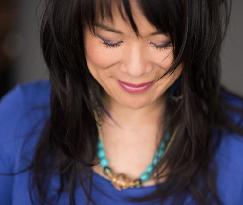 Dr. Tanya Gee, doctor of Traditional Chinese Medicine, smiling peacefully.
